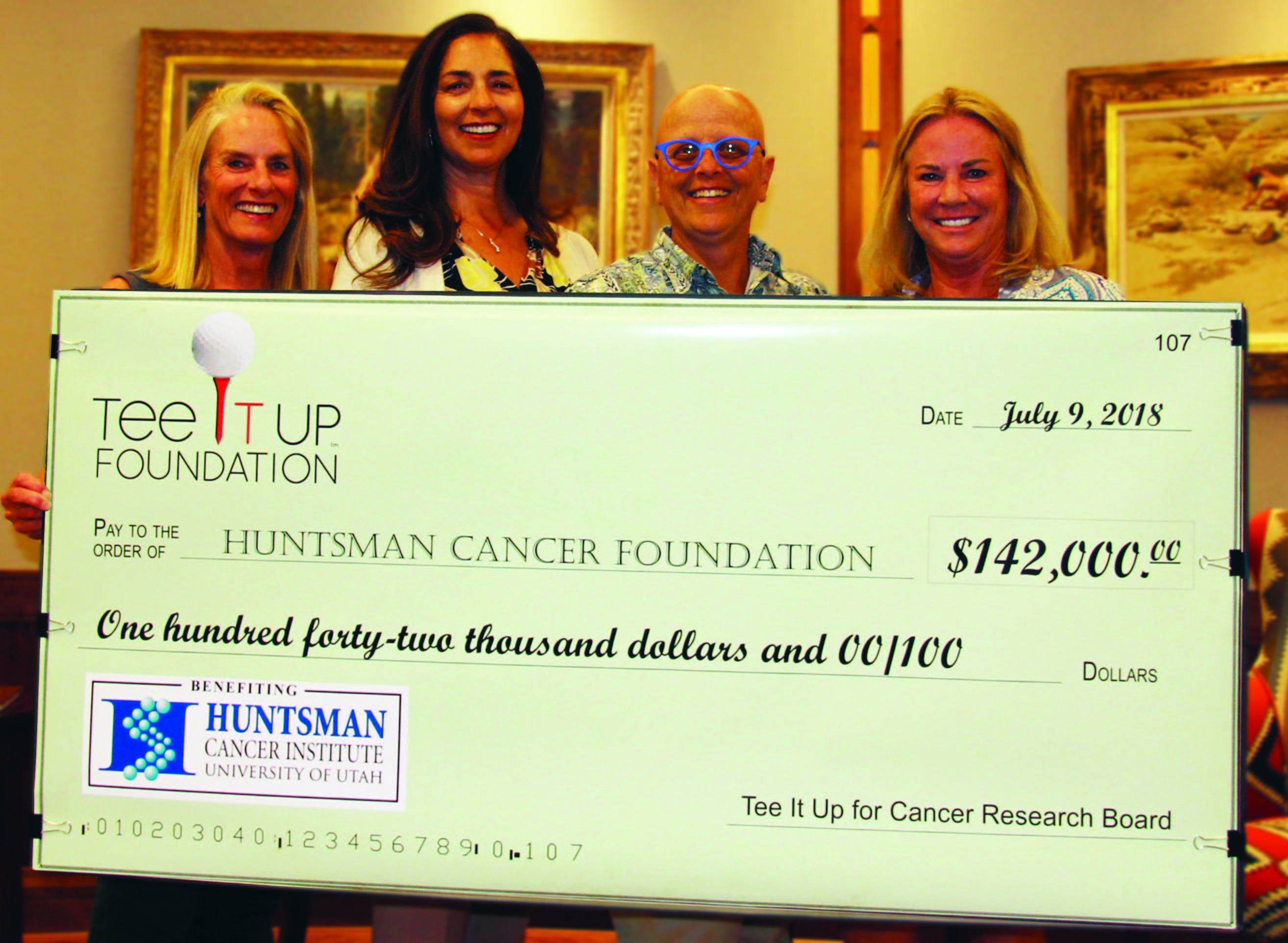 Teeitup foundation presents Huntsman Cancer Foundation a check for $142,000 2018